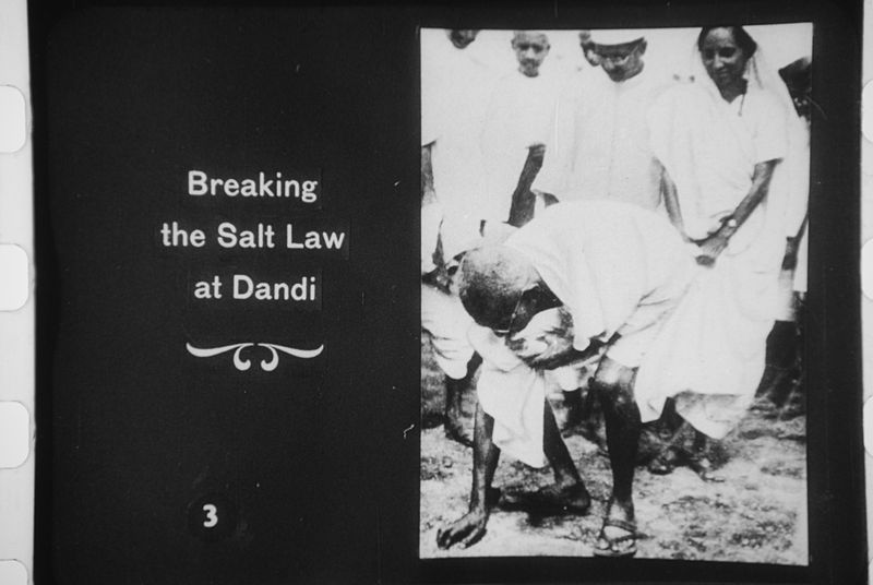 File:Gandhi picking up salt at Dandi.JPG