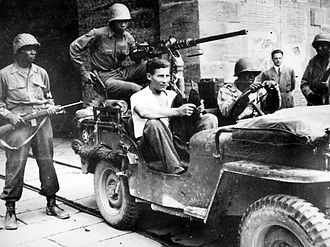 92nd Infantry Division (United States) - Soldiers of the 92nd Infantry Division with a captured German soldier.