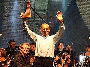 Nai (pan flute) - Gheorghe Zamfir holding a nai