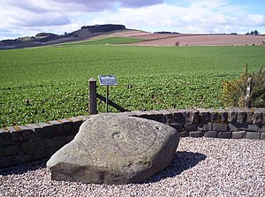 Letham, Angus - The Girdlestane, on the northern edge of Letham, a cup and ring mark monument, looking towards Dunnichen Hill