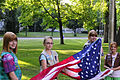 Girl scouts raising US flag.jpg