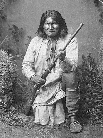 Geronimo - Geronimo (Goyaałé), a Bedonkohe Apache; kneeling with rifle, 1887