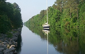 Dismal Swamp Canal - A sailboat on the Dismal Swamp Canal