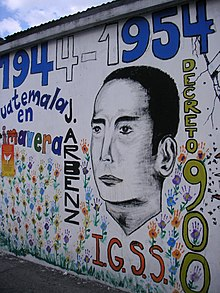 Mural incorporating many spring flowers and the likeness of Árbenz