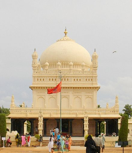 The mausoleum housing Tipu's tomb is another example of Islamic architecture. Tipu's flag is in the foreground. Gumbaz.jpg