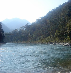 Manas River - A suspension bridge across the Manas River in reserved area of the Park