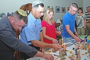 American Jews - US military and civilian personnel light Menorahs in observance of Hanukkah