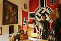 "Hitler portrait painting, Nazi Germany Reich service-Kriegsmarine swastika flags, SS uniform-helmet, RAD clock, wine bottle ice bucket, etc. in ""Gestapo office"" at Lofoten Krigsminnemuseum, Norway 2019-05-08 DSC00176.jpg"