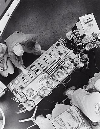 Operating theater - An operating room in the United States, c. 1960. Heart-Lung Machine with rotating disc oxygenator
