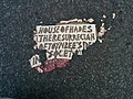 House of Hades Toynbee tile at 20th and 6th Ave in New York City November 2013.jpeg