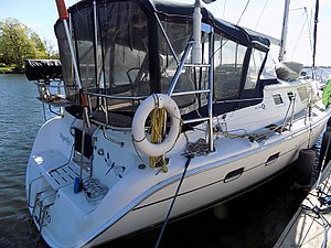 Hunter 44 - Hunter 44 stern view, showing transom details and enclosed cockpit with dodger and Bimini top combination
