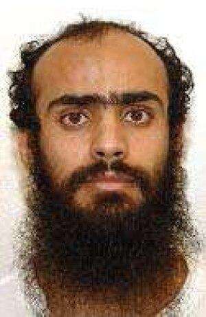 Ali Ahmad Muhammad Al Rahizi - Ali Ahmad Muhammad al-Razihi's official Guantanamo identity portrait, showing him wearing the white uniform issued to compliant individuals