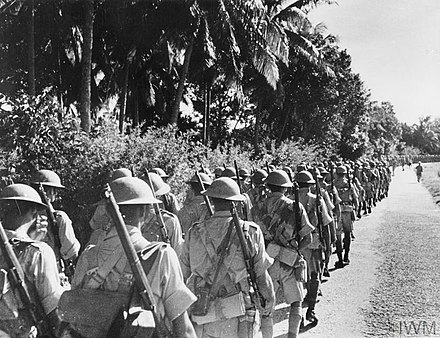 Indian troops march in Malaya