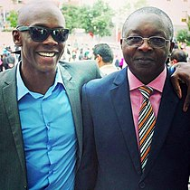 Adesanya (left) with his father Femi, August 2014