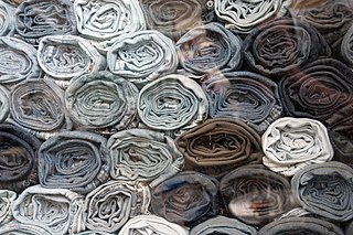 Stack of blue jeans in england