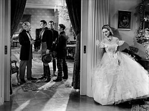 Jezebel (film) - George Brent (second from left) and Bette Davis in Jezebel