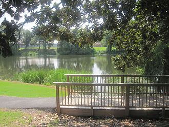 Arnold R. Kilpatrick - Attractive Chaplin's Lake Walking Trail follows the path of Cane River; photo taken from street in front of the residence of the NSU President.