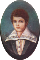 Half-length portrait of a boy with light hair and wearing a jacket over a shirt with an enormous, embroidered collar.