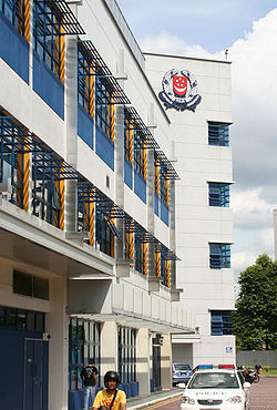 The Jurong Police Division Headquarters at Jurong West Avenue 5. The Singapore Police Force logo is prominently displayed.