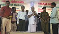 K.R. Periyakaruppan distributing cash incentives of NYKS to selected youth clubs in Tamil Nadu, on the opening day of Bharat Nirman Public Information Campaign, at Manamadurai in Sivaganga District, Tamil Nadu.jpg