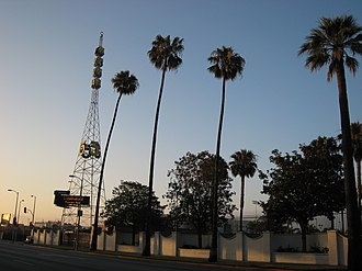 KTLA - KTLA tower on Sunset Boulevard in 2007. The tower was erected in 1925, and was one of two radio towers that served Warner Bros.-owned radio station, KFWB, from the Warner Brothers Studio (now Sunset Bronson Studios) in Hollywood; the second tower was permanently removed in 1950. KTLA moved to the property in 1955, and added its call letters to the structure, which was moved to another spot on the property; the tower was relocated back to its original site in 2015. The station does not actually broadcast from this tower, with its main transmitter being positioned atop Mount Wilson.