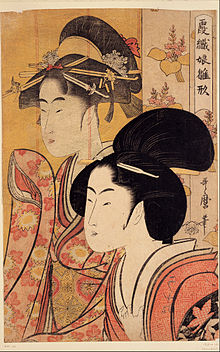 A colour print of a close-up of the head and upper torso of a finely dressed Japanese woman. Behind her is a bamboo screen on which is depicted a similar woman's head and upper torso.