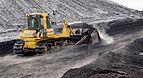 Komatsu bulldozer pushing coal in Power plant Ljubljana (winter 2017).jpg