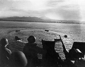 Landing craft circle while awaiting landing orders during the invasion of Cape Torokina, Bougainville, 1 November 1943