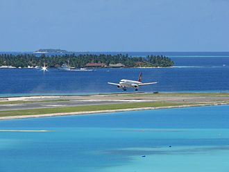 Plane landing on an airport island, Velana International Airport, Hulhule Island, Maldives Landing Runway 18 (2121588367).jpg