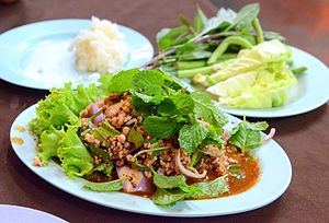 Larb moo: made with pork, served with raw vege...