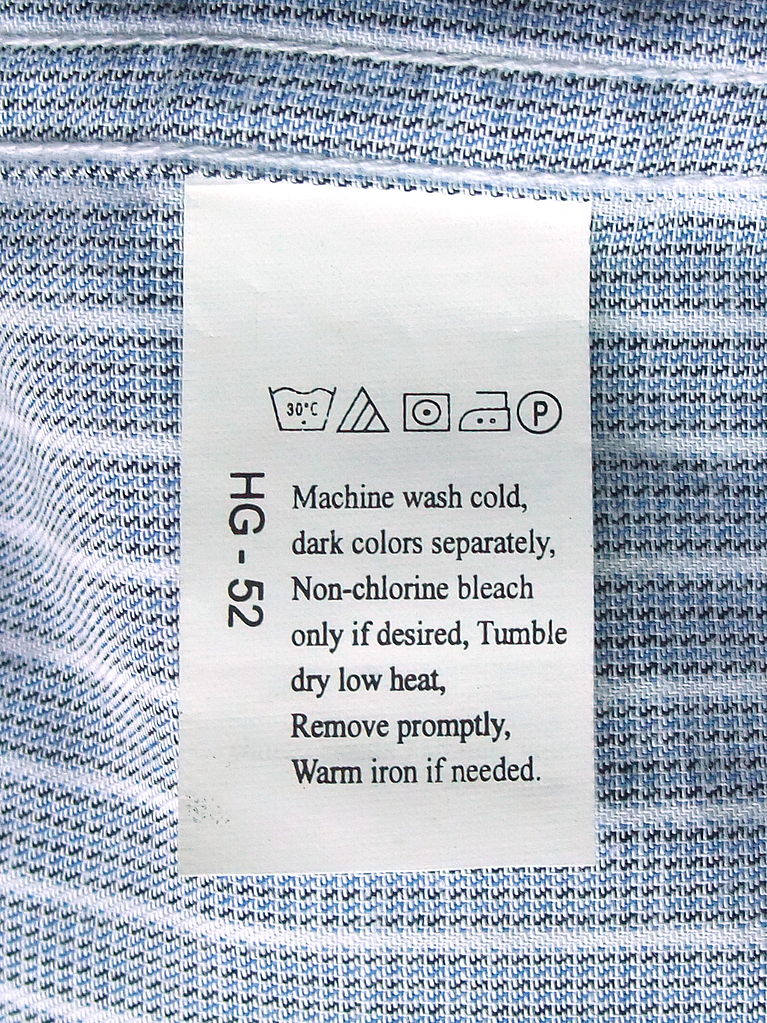 File Laundry Symbols On A Care Label Attached To A Shirt