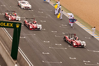 2010 24 Hours of Le Mans - The podium was held by Audi's No. 9, 8, and 7 LMP1 cars