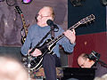 Les Paul with his guitar.jpg