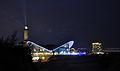 Leuchtturm Warnemünde mit Teepott und Hotel Neptun im Hintergrund.jpg