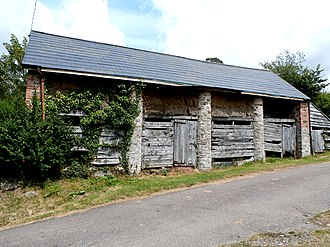 Linhay - Linhay at Poole Farm, Exebridge, Devon. Hay is stored in the tallet or hay-loft above and cattle is housed over winter below. The full-height columns are of rubble-stone and lime-mortar