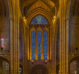 "Liverpool Cathedral - The cathedral's west window by Carl Johannes Edwards. The uppermost window is the Benedicite window. The pink neon sign by Tracey Emin reads ""I felt you and I knew you loved me"" and was installed 2008 when Liverpool became European Capital of Culture."