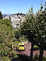 Lombard Street, cab, and Coit Tower.jpg