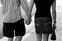 Male and female couple holding hands