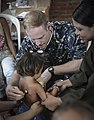 Lt. Andrew Smith checks the breathing of a Colombian child. (33376358050).jpg