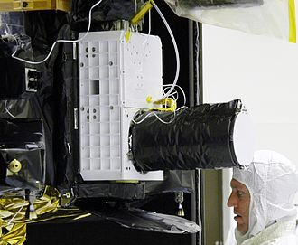 Compact Reconnaissance Imaging Spectrometer for Mars - A NASA engineer and the CRISM instrument.