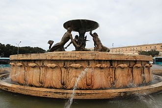 Triton Fountain (Malta) - View of the fountain showing the reliefs on the travertine base