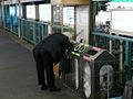 Man inspecting garbage bins in tokyo.jpg