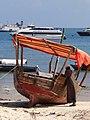 Man with Boat - Port Area - Stone Town - Zanzibar - Tanzania (8841658970).jpg