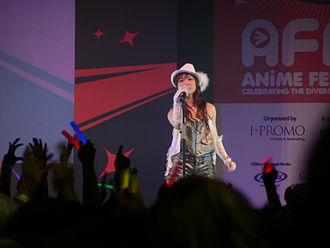 May'n - May'n performing at Anime Festival Asia 2008, in Singapore, November 2008