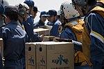 Members of the JMSDF prepare to load supplies onto an MV-22B Osprey aircraft. (26516036866).jpg