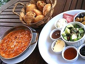 Menemen (food) - Turkish breakfast with Menemen (left)