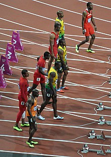 Mens 100m Final - Prowling before the start - 2012 Olympics.jpg