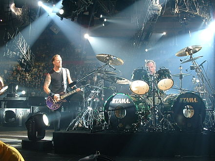 Metallica performing during its Madly in Anger with the World Tour in 2004 Metallica 46.jpg