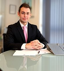 Minister for Business and Employment, the Honourable Neil F Costa MP.jpg