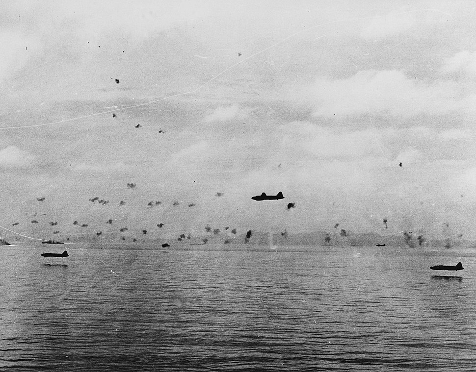 Mitsubishi G4M1 bombers attack the invasion force between Guadalcanal and Tulagi on 8 August 1942 (80-G-17066)